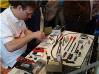 Claudius Veit from Velmo in action mounting a decoder in an engine.